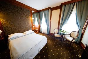מיטה או מיטות בחדר ב-Hotel Select