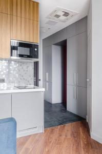 A kitchen or kitchenette at IQ-апартаменты в Москва-Сити