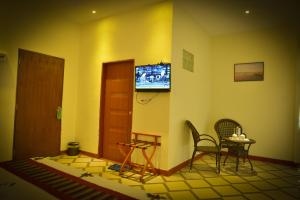 A television and/or entertainment center at Ocean Blue Beach Hotel