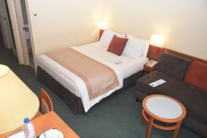 A bed or beds in a room at Hôtel Sawa