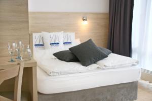 Ein Bett oder Betten in einem Zimmer der Unterkunft Miratel