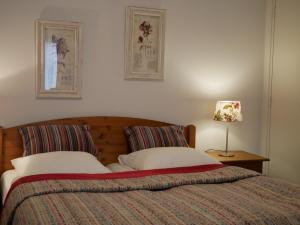 Een bed of bedden in een kamer bij Appartementen de Strandloper