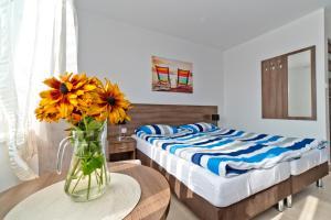 Łóżko lub łóżka w pokoju w obiekcie Willa Aura Mare
