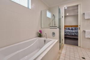 A bathroom at Pavillions on Hamilton Island
