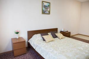 Кровать или кровати в номере Гостиница & Хостел Клевер