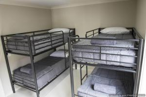 A bunk bed or bunk beds in a room at Paringa Resort