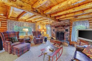 A seating area at Irresistible Schroon River Front Log Cabin