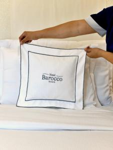 A bed or beds in a room at Hotel Barocco
