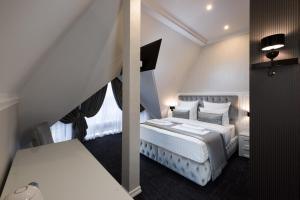 Кровать или кровати в номере Бутик отель Столица