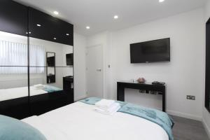 A bed or beds in a room at BlueGreen Suites