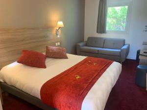 Un ou plusieurs lits dans un hébergement de l'établissement The Originals City, Hôtel Costières, Nîmes (Inter-Hotel)