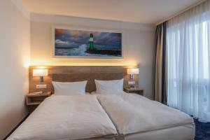 Ein Bett oder Betten in einem Zimmer der Unterkunft Pension StromInn