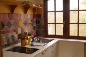 Küche/Küchenzeile in der Unterkunft Petite Bellevue