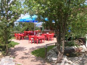 Ein Restaurant oder anderes Speiselokal in der Unterkunft Zimmer Mamma Mia