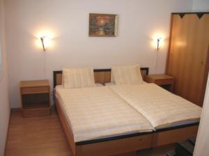 Ein Bett oder Betten in einem Zimmer der Unterkunft Zimmer Mamma Mia