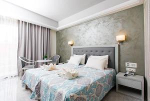 Ένα ή περισσότερα κρεβάτια σε δωμάτιο στο Anita Beach Hotel