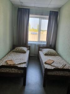 Кровать или кровати в номере Отель «Гостинный Двор»