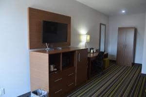 A television and/or entertainment center at Super 8 by Wyndham Windsor/Dougall