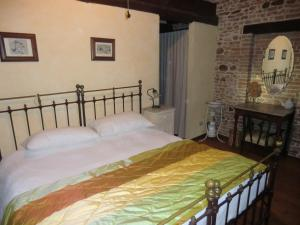 A bed or beds in a room at Agriturismo Case Mori