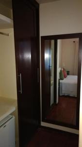 Uma cama ou camas num quarto em Pousada dos Girassóis