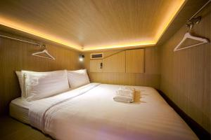 A bed or beds in a room at CUBE Boutique Capsule Hotel @ Kampong Glam (SG Clean)