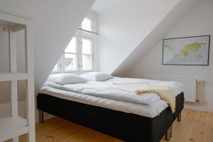 A bed or beds in a room at Cozy apartment in Christianshavn, Copenhagen