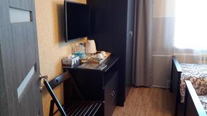 Телевизор и/или развлекательный центр в Гостиница Аврора