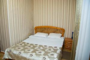 Кровать или кровати в номере Отель «Афродита»