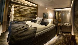 Vuode tai vuoteita majoituspaikassa Arctic Hilltop Boutique Hotel Iso-Syöte