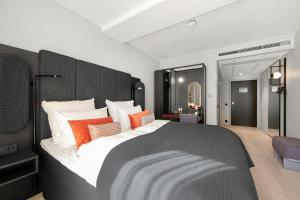 A bed or beds in a room at Clarion Hotel Oslo