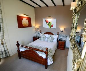 A bed or beds in a room at Ardlui Hotel