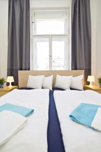 A bed or beds in a room at Apartment-hotels RENTeGO