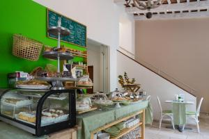 A restaurant or other place to eat at Billini Hotel, Historic Luxury