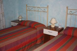 Letto o letti in una camera di B&B Casa Di Mari