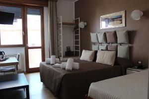 Letto o letti in una camera di Hotel Franchi
