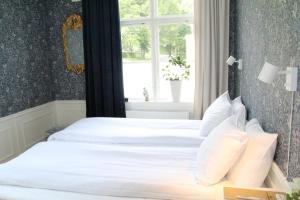 Säng eller sängar i ett rum på Asa Herrgård