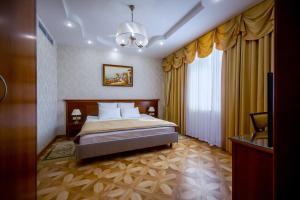 Кровать или кровати в номере Гостиница Белгород