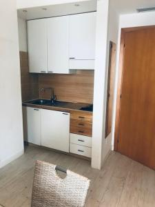 A kitchen or kitchenette at Residence Alexandra Stay