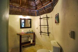 A bathroom at Las Palmas Maya
