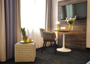 A seating area at Lizz Hotel Munich