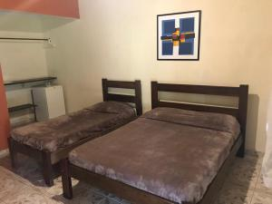 A bed or beds in a room at Pousada da Rosa