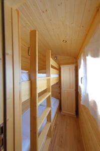 A bunk bed or bunk beds in a room at Le Castel du Mont Boisé