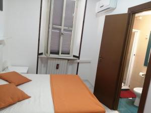 Кровать или кровати в номере Albergo Ollolai