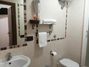 Ванная комната в Albergo Ollolai