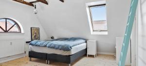 Cama o camas de una habitación en Stay Bai-Jensen
