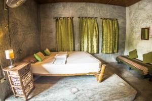 A bed or beds in a room at The Earth House