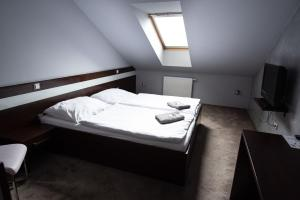 Postel nebo postele na pokoji v ubytování Penzion u Trávníčka
