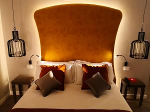 A bed or beds in a room at Hotel Campo Marzio