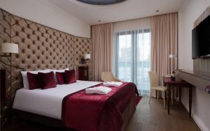 Кровать или кровати в номере Меркюр Москва Павелецкая
