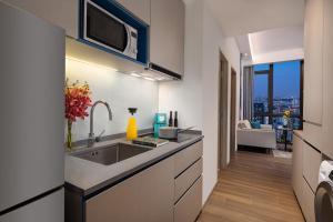 A kitchen or kitchenette at Citadines Balestier (SG Clean)
